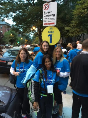 From left, Mary Harper, Savannah Eades, Raela Villanueva, and Linda Price of the Dream Team reach mile 1 of The Overnight Walk in Boston.