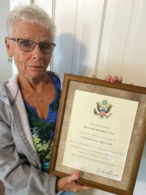 Leah Woods holds a certificate signed by President Franklin D. Roosevelt that honors her father, Pfc. Wayne Clark, who died in action near the end of World War II.