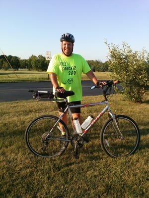 Roger Booth, 42, a third-grade teacher at O.H. Schultz Elementary in Mishicot, will attempt a 200-mile bike ride from his home in Two Rivers to his family's home in Stanley, Wisconsin, to raise awareness and funding for cancer research.