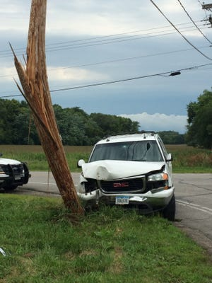 Two crashed their car into a utility pole July 28, 2015 and the driver then ran after being cuffed by officers.