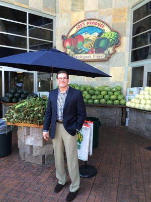 Joe Maiorana Jr. stands in front of the entrance into Joe's Produce, featuring an outdoor display as tribute to the fruit stand his grandfather built to start the family business.