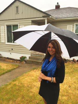 Blair Browne didn't have college debt like many of her contemporaries, so she had to get a few credit cards and buy a car to establish a credit record to get a mortgage. She's glad she did, and didn't let last week's rain dampen enthusiasm about her new house.