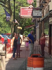 Local business owners gather after a fire destroyed Kelly's Saloon and forced neighboring business to shut down.