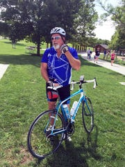 Scott Carroll goes biking Wednesday, July 29, 2015, along the Neal Smith Trail along Saylorville Lake and Big Creek State Park. He continues to recover after he was hit by a car on his bike on July 10, 2014.