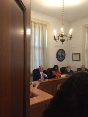 Pocomoke City Mayor Bruce Morrison, at left, speaks during the Monday night Mayor and City Council meeting.