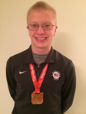 Robert Griswold with his bronze medal.