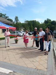 LaVerne Becker, center, of Montville, cuts a ribbon on opening day of the John Becker Lincoln Park/Montville Farm to Table Market, named in memory of her late husband. Montville administrator Victor Canning, left, holds the ribbon, with Montville mayor Scott Gallopo and Lincoln Park council president Ann Thompson, right.