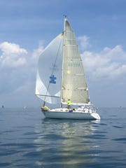 On a picture-perfect afternoon, the sailboat Shape and its crew get underway in the annual Port Huron-to-Mackinac race.