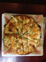 Don's Seafood Hut offers an off-menu shrimp scampi pizza.