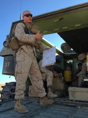 Lt. Michael Terreri talks about the live-fire exercise from the back of an amphibious assault vehicle at Marine Corps Air Ground Combat Center in Twentynine Palms on Sunday, Aug. 16, 2015.