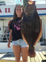 Gabby Greager 13 of Shamokin, Pennsylvania with a fluke caught aboard the Jamaica II out of Bogans Basin Brielle.
