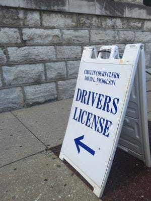 Signage directs patrons to a downtown driver's license branch in Louisville.