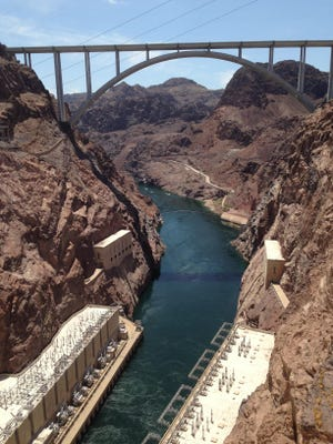 A view from the Hoover Dam on the Arizona-Nevada border looking toward the O'Callaghan-Tillman Memorial Bridge. The dam is considered a civil engineering wonder. It's located about 30 minutes from Las Vegas and is a top destination in the region.