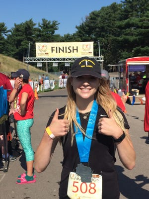 Melanie Lawder after she completed the half marathon at the fourth annual Wausau Marathon, Half Marathon & 5Kat Marathon Park on Saturday.