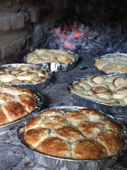 Cinammon and coconut bread bake to golden-brown perfection in a traditional Spanish oven called a hotnu. It's located in Inarajan.