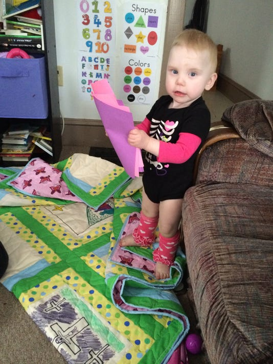 1-year-old Violet Martin takes a look at the gifts sent to her from Berwick