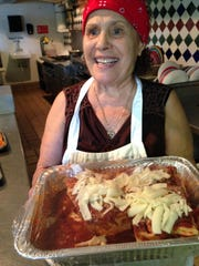Angela Rosaria Leone shows her homemade lasagna at Leone Italian Food & Specialty in Cape Coral.