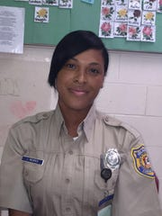 """Correctional officer Jonina Respes says the """"6 for 1"""" program makes the cell block more peaceful than the other main housing unit for detainees."""