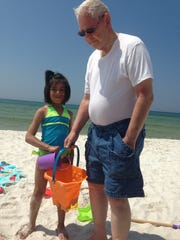Maya Leachman, then 6, on vacation with her grandfather, Charlie Leachman, who has Alzheimer's disease.