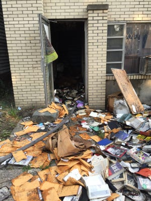 The front door of Ad Infinitum Books on N. MacQuesten Parkway in Mount Vernon after a fire Monday, August 31, 2015.
