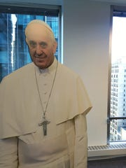 A cardboard cutout of Pope Francis greeted guests at the Airbnb information session held at the Pipeline in Center City Philadelphia.