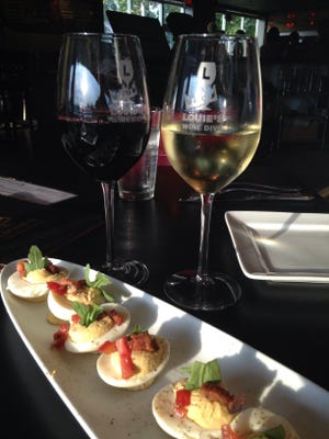 The BLT Deviled Eggs and glasses of wine at Louie's Wine Dive.