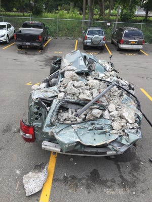 Jeff Kraham's Toyota SUV sits in a lot after being removed from the debris of the UHS Wilson Medical Center garage collapse last July.