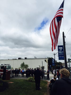 Toms River police, firefighters and EMS personnel stand in formation during a remembrance ceremony Friday morning honoring those who lost their lives in the Sept. 11, 2001 terrorist attacks 14 years ago.