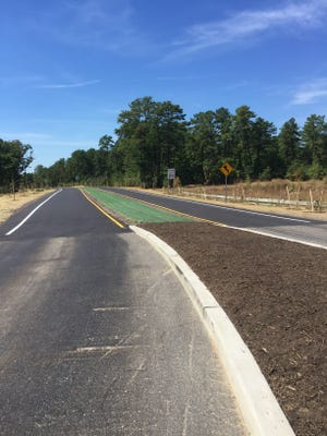 West College Drive opened Wednesday. The new road is 30 feet wide and includes three culverts, 4,000 feet of guide rail, access to natural lands, speed tables and turtle crossing signs, according to Ocean County officials.