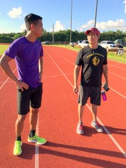 Geckos' head coach Jeofry Limtiaco and Friars' head coach Brian Galang talk during their IIAAG cross country meet on Thursday at GW