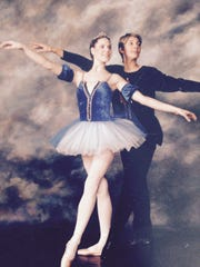 Amie Olson shown posing with her former ballet instructor,