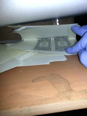 St. George Police officers found evidience of a counterfeiting operation in a Dixie Downs aparment building the week of Wednesday, Sept. 23, 2015.