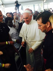 Pope Francis visits with people eating at a Catholic Charities soup kitchen in Washington, D.C.