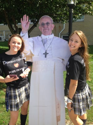 """Rebecca Case, left, and Brooke Sobieski pose with the """"selfie pope"""" at Donovan Catholic High School's """"PopeWatch"""" event in Toms River."""