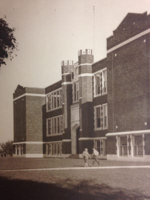 A 1940s view of students in front of the now-100-year-old building.