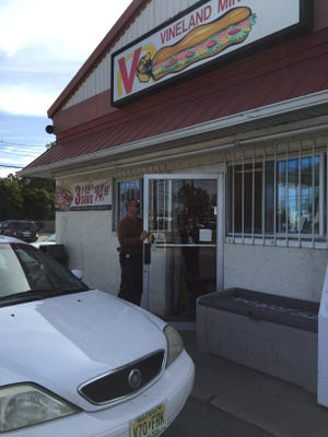 Vineland detective Michael Fransko was at the Vineland Mini Deli at Mill Road and Landis Avenue,  on Friday morning, investigating an armed robbery reported Thursday evening.