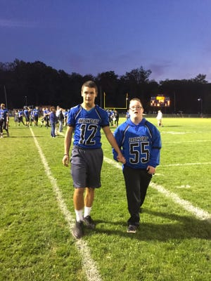 BHS football player Jon Yaeger, left, with the team's honorary homecoming captain Jacob Noyes, right. photo by Caurie Putnam