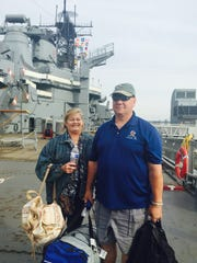 John and Barbara Lammé of a Washington, D.C. suburb head out Saturday to Philadelphia from bunking on the battleship New Jersey to be a part of the Festival of Families events for Pope Francis' visit to the city.