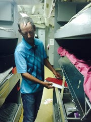 Former battleship New Jersey crew member John Crapp of Davenport, Iowa, bunks on his now retired ship in Camden on his first return since serving during the Beirut Crisis as a ship repairman. He hopes to see the Pope in Philadelphia.
