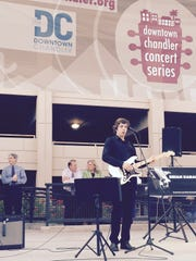 Brian Kabala of Chandler entertains the crowd during the opening of the city's new Downtown Stage. Looking on are City Councilman Rick Heuman (left)  Mayor Jay Tishraeny and Terri Kimble, Chandler Chamber of Commerce President and CEO.