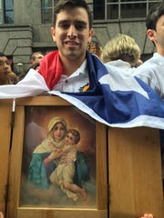 """24-year-old Carlos Licona was stuck less than a block from the general public entrance to the papal parade. """"I'm OK with it, I'm just hanging out with my friends and making jokes and singing,"""" said Licona, from the University of Texas at Austin."""