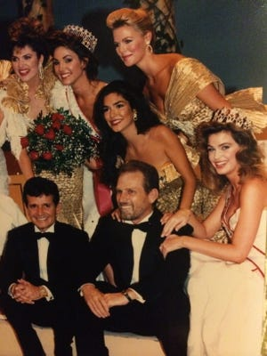 "Richard Guy, left, and Rex Holt with some of their beauty queen ""girls."" The two, known as GuyRex, dominated the beauty queen scene in the 1980s. Holt died Friday."