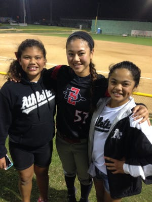 Jade Ignacio (left) and Quincee Lilio (right) support Jaylene Ignacio (center) at one of her softball games in Cathedral City. All three are granddaughters of Eddie Aguon, a former Guam Major League player.