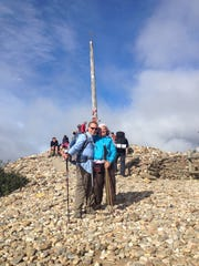 With Morgan at the Iron Cross on the Camino. The remembrance stones are left by previous pilgrims over the years