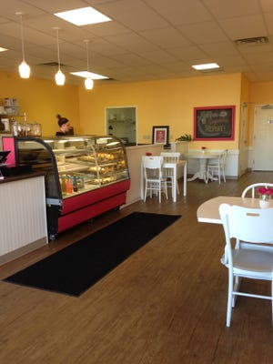 An employee at Sugar's Baked Goods and Sweet Treats works behind the counter in the newly remodeled space.