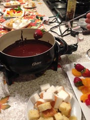 Strawberry dipped in chocolate fondue