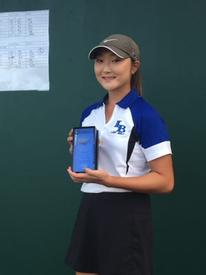 Ida Baker's Brittany Shin fired a female course-record 64 to win the District 2A-20 tournament Tuesday at Fort Myers Country Club.