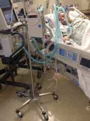 Danny Burden in the intensive care unit at St. Luke East Hospital shortly before his death on April 4, 2013.