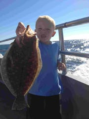 Seamus Gillespie of Philadelphia, with a keeper he caught aboard the Jamaica II out of Bogan's Basin, Brielle.