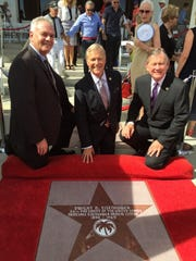 From left, Eisenhower Medical Center Vice President and Chief Operating Officer Martin Massiello; Michael Landes, President, Eisenhower Medical Center Foundation and Eisenhower Medical Center CEO Aubrey Serfling at the unveiling of Dwight Eisenhower's star on the Palm Springs Walk of Stars on Wednesday, Oct. 14, 2015.